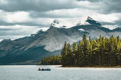 A canoe on maligne lake in summer with a backdrop of the canadian rockies in jasper national park, alberta, canada. Photo taken in Jasper National Park Royalty Free Stock Photo