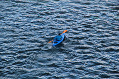 Canoe. Man in a blue canoe on a lake Royalty Free Stock Image