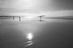 Canoe mists. Surf ski in early morning mists on Fish hoek beach,Cape Town Royalty Free Stock Image