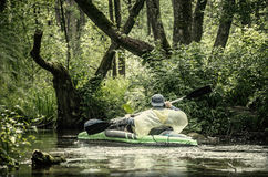 Canoe misty lake Stock Photography