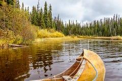 A Canoe moored in McGillivray Lake Royalty Free Stock Photos