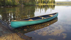 Canoe on a mountain lake in Oregon Royalty Free Stock Photo