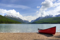 Canoe next to Bowman Lake Royalty Free Stock Photos