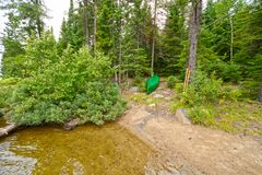 Canoe in a North Woods Campsite Royalty Free Stock Images