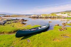 Canoe in Norwegian fjord Royalty Free Stock Photos