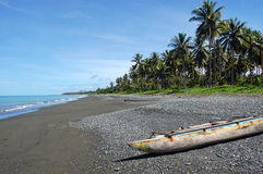 Canoe at ocean coast. Papua New Guinea Royalty Free Stock Images