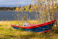 Canoe. Old wood canoe by the lake Stock Photos