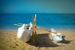Canoe with outrigger on sand Stock Photo