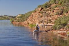 Canoe paddler on a mountain lake Stock Photos