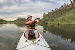 Canoe paddler photographing Stock Image