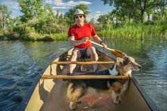 Canoe paddling with dog Royalty Free Stock Photos