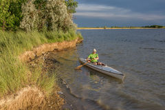Canoe paddling on lake in Colorado Royalty Free Stock Photo