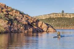 Canoe paddling on a lake Stock Images