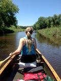 Canoe paddling on small stream Royalty Free Stock Photos