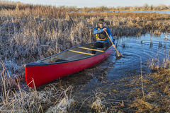 Canoe paddling through a swamp Stock Image