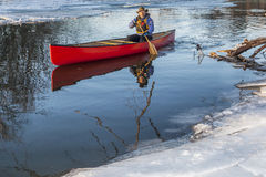 Canoe paddling in winter Stock Photo