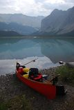 Canoe by placid lake Stock Images