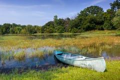 Canoe on the Pond Royalty Free Stock Photos