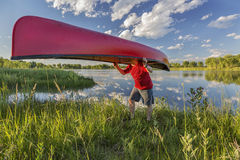 Canoe portaging Stock Photos