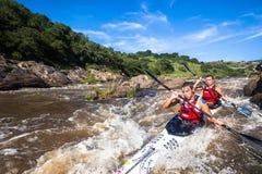 Canoe Race Rapids Action stock photography