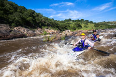 Canoe Race Rapids Action. David Wood/Kelvin Trautman canoe race action  at Mission Rapids with paddlers going through rushing river waters Stock Photos