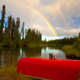 Canoe and Rainbow Stock Photo