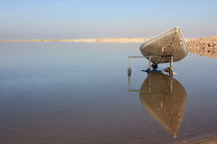 Canoe, reflecting in the mirror of the Dead sea Royalty Free Stock Photos