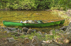 Canoe on a Remote Lake Shore Stock Photo