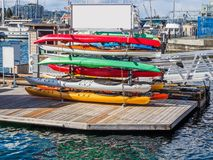 Canoe for rent. Stack of canoe for rent at the boat marina Stock Image