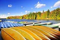 Canoe rental on autumn lake royalty free stock image