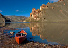 Canoe rests on the shore of a lake Royalty Free Stock Photo