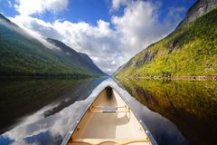 Canoe ride. Boat on river Stock Photos