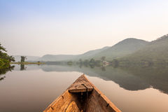 Canoe ride in Africa. Canoe ride to tropical island in Africa Royalty Free Stock Photography