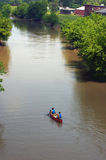 Canoe on the River. Canoe going up the river in Galena, Illinois, next to Grant Park Royalty Free Stock Image