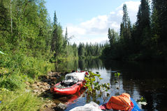 Canoe on the river in the virgin forests of Komi. Royalty Free Stock Photos