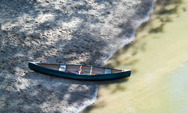 Canoe on the rivers edge Stock Photo