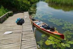 Canoe on the riverside Stock Images