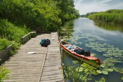 Canoe on the riverside Royalty Free Stock Image