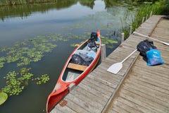 Canoe on the riverside Stock Image