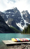 Canoe in Rockies. Morane Lake in Canadian Rockies mountains is a tremendous place to practice this sport Stock Photography