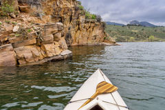 Canoe and sandstone cliff Stock Image