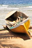 Canoe of sandy beach Stock Images