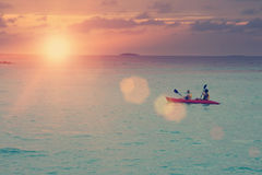 Canoe in the sea on a sunset, Stock Image