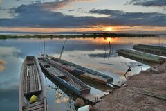 Canoe on Seashore during Sunset Stock Image