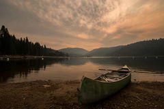 Canoe on shore at Pinecrest Lake in California Royalty Free Stock Image
