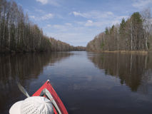 Canoe on the spring river. The kayak slides along the spring water stock image