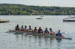 Canoe on Starnberger lake, Germany. Unidentified young tourists practice canoe on May 27, 2016 on Starnberg lake, Bavaria, Germany Royalty Free Stock Images