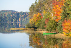 Canoe on still lake Autumn Royalty Free Stock Photography