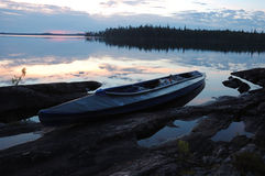 Canoe at stone bank of Engozero lake,Polar Karelia, Russia Stock Image