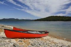 Canoe sulla riva Fotografia Stock